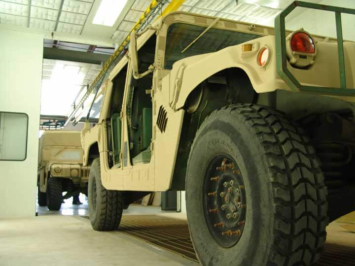 HUMVEE's in the drive-through spray booth