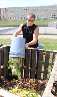 Students took turns hauling food waste from the cafeteria to the compost site.