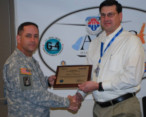 Elsbernd Receives Award from Col. Michael Aid