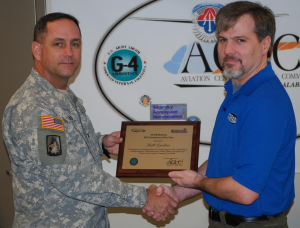 Gerebis Receives Award from Col. Michael Aid