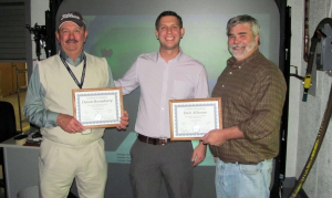Graig Jolley from the USMC CPAC (middle) presented Dennis Rosenberry (left) and Dale Alleman (right) with their instructor certifications.